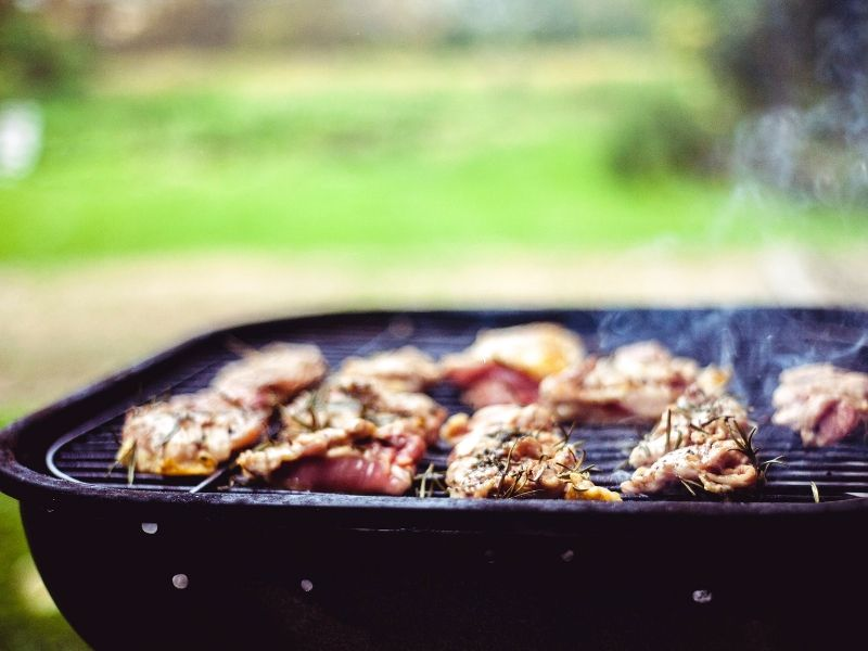 grill with meat on it.