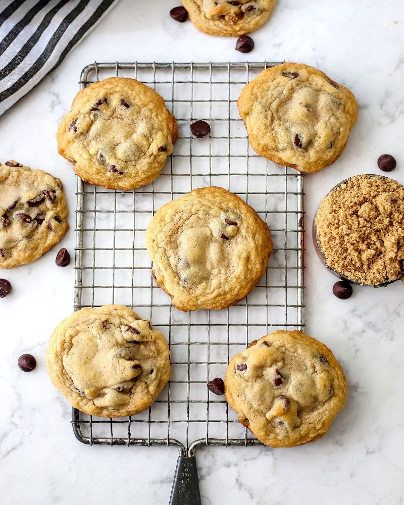 Chocolate chip cookies on a baking rack