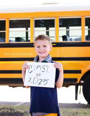 A person standing in front of a school bus