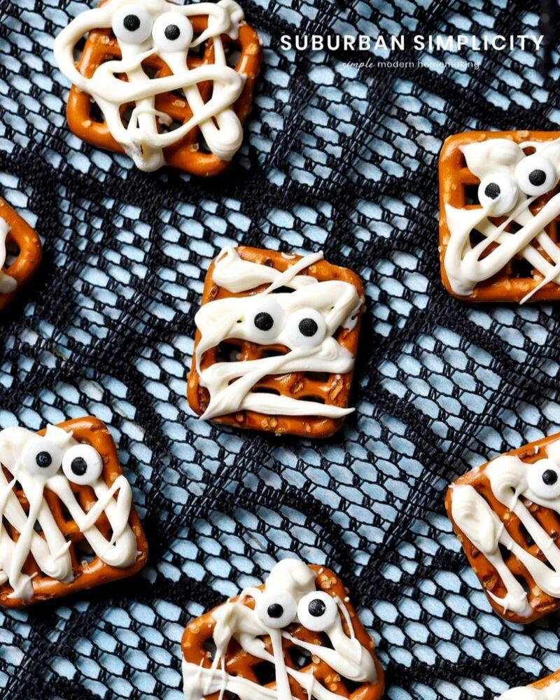 Mummy pretzels on a spider web background