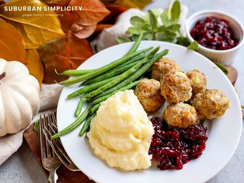 turkey stuffing meatballs plated with mashed potatoes and cranberry sauce