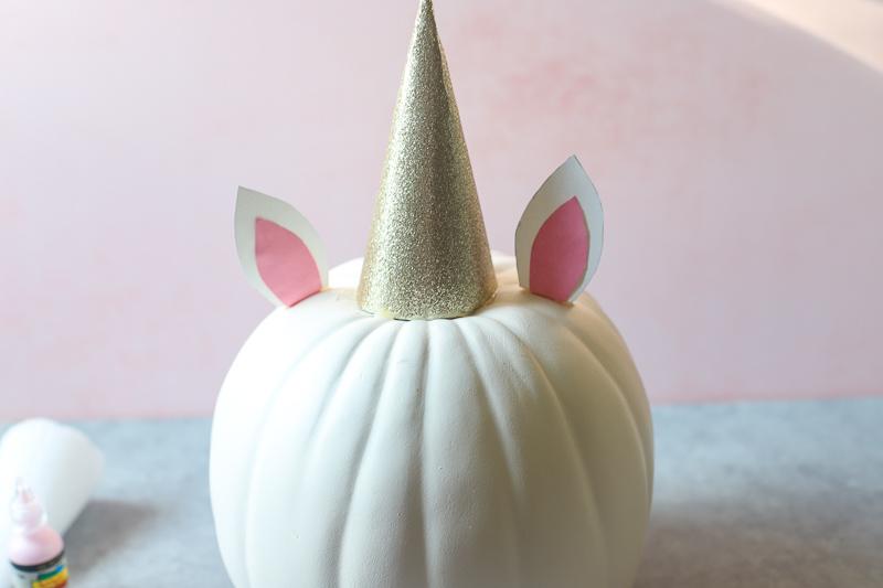 ear glued on a pumpkin