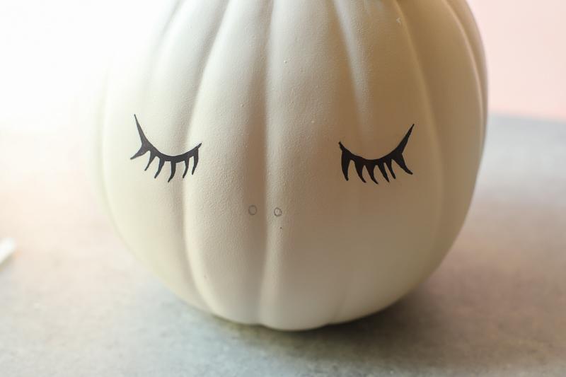 sharpie drawn Eyelashes on pumpkin