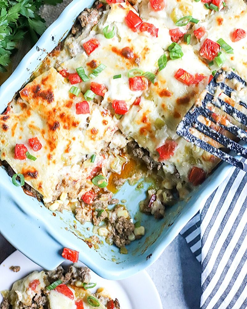Beef enchilada casserole with a piece cut out.