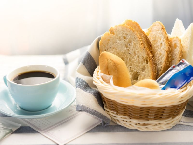 Bread in a basket with coffee