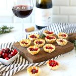 Cranberry Brie Bites are a deliciously easy way to entertain guests! With only 3-ingredients you have a wonderful bite-sized appetizer to serve at your next party!