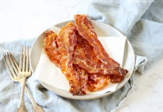 Follow these tips for How to Cook Bacon in the Oven for less mess and a deliciously easy snack or addition to any meal!