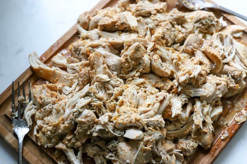 Shredded chicken for buffalo chicken in the crockpot.