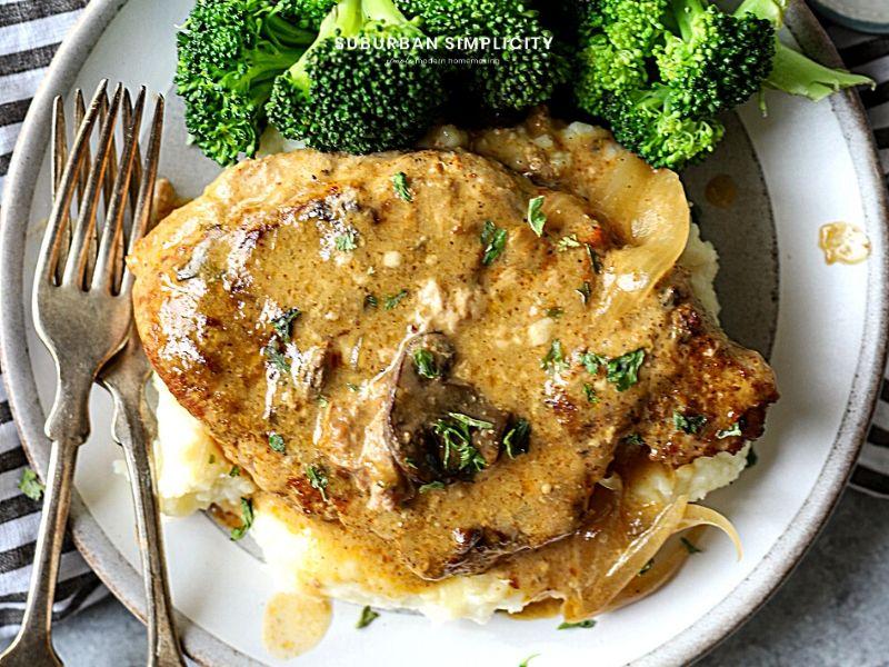 CrockPot Pork Chops on a plate with mashed potatoes