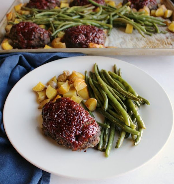 A bunch of food on a plate, with Meatloaf