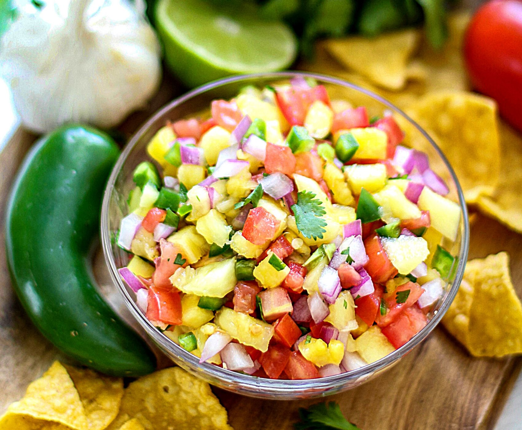 Fresh Pineapple Salsa is an incredibly easy recipe that wows both in flavor, and it's colorful presentation. With a few simple ingredients, you have a healthy snack, appetizer, or recipe topper that's not only flavorful; it's light and 100% delicious!
