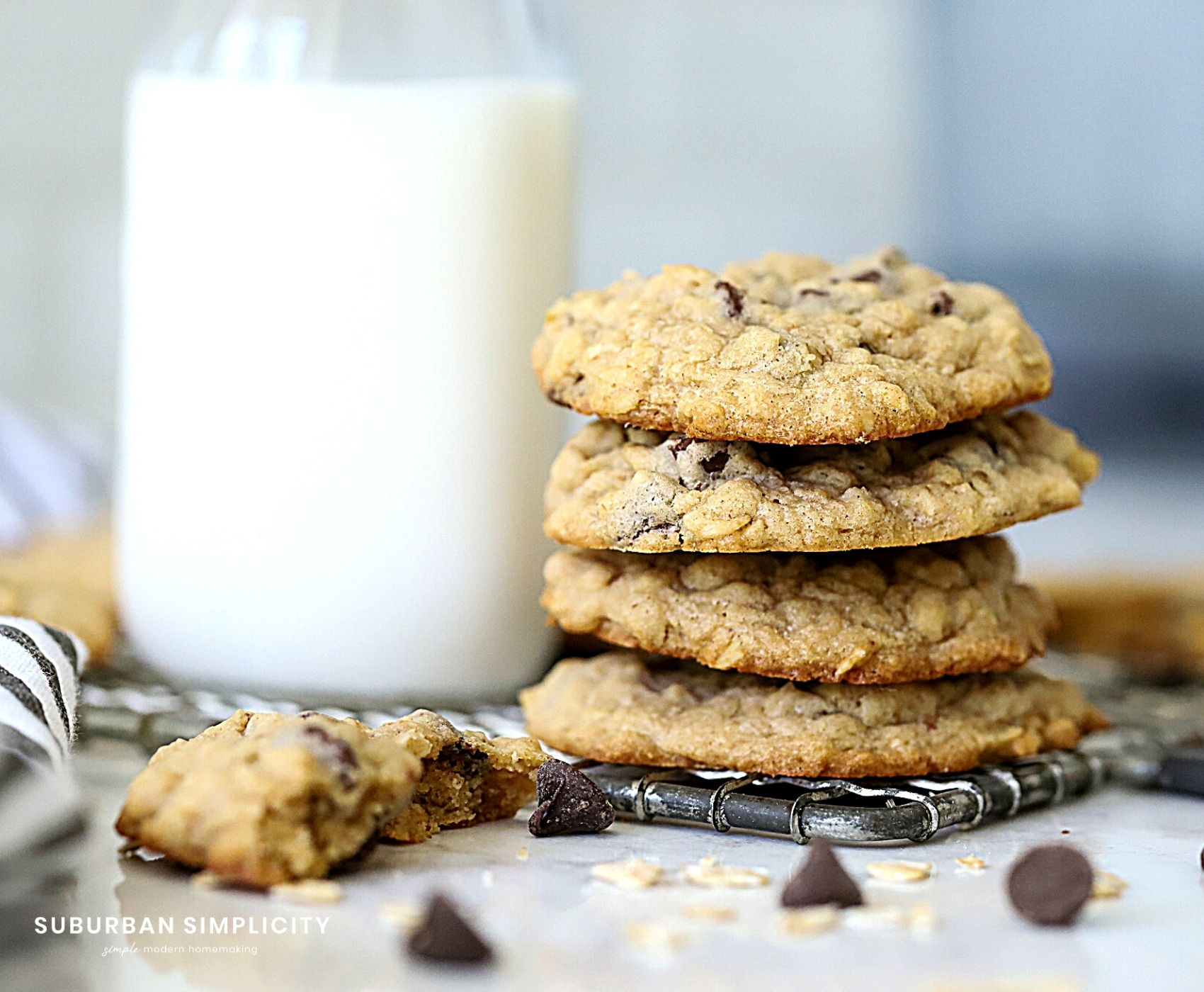 The Best Oatmeal Chocolate Chip Cookies next to a glass of milk