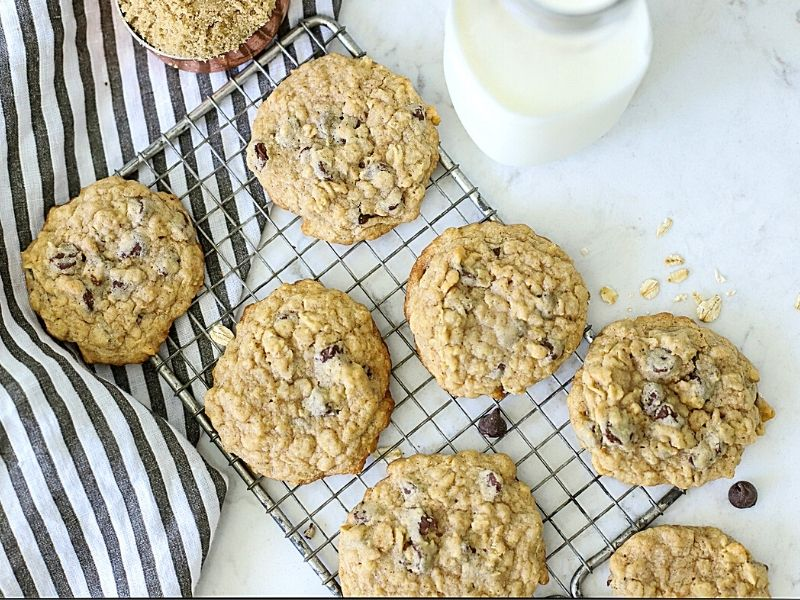 Chewy chocolate chip oatmeal cookies on a cooling rack.
