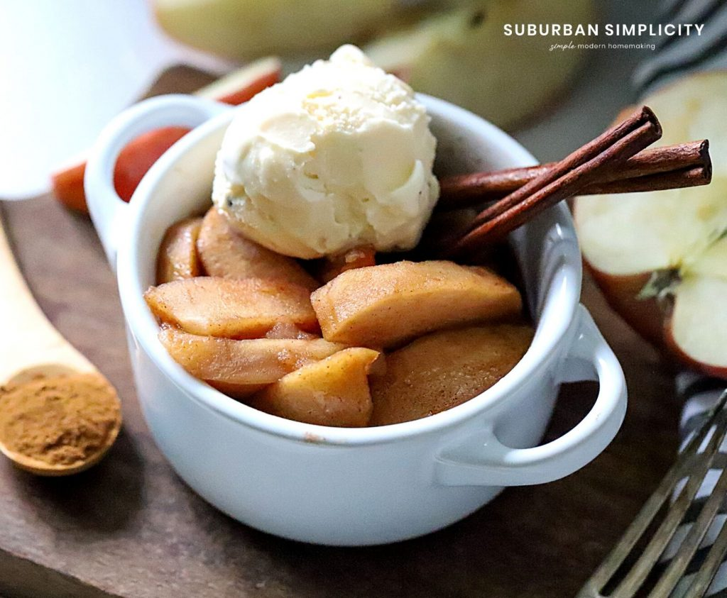 Crockpot Apples in a bowl with ice cream on top