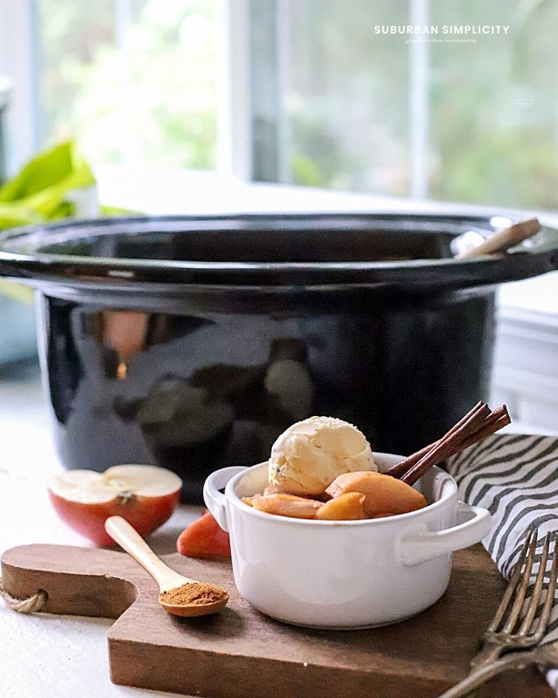 Bowl of baked apples in front of a crockpot
