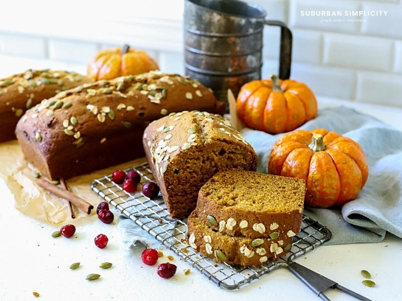 A large batch of pumpkin bread on a counter