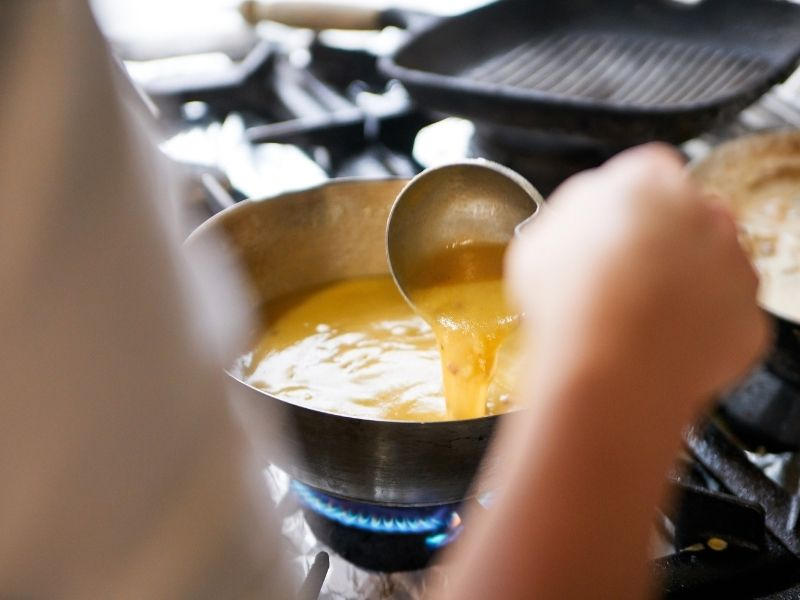 gravy cooking on a stove