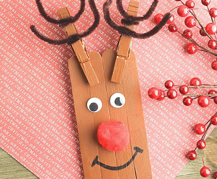 Reindeer Craft on a piece of Christmas paper