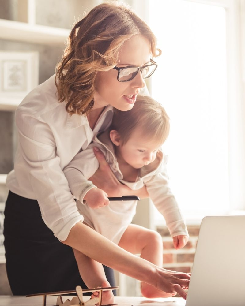mom working with baby in arms