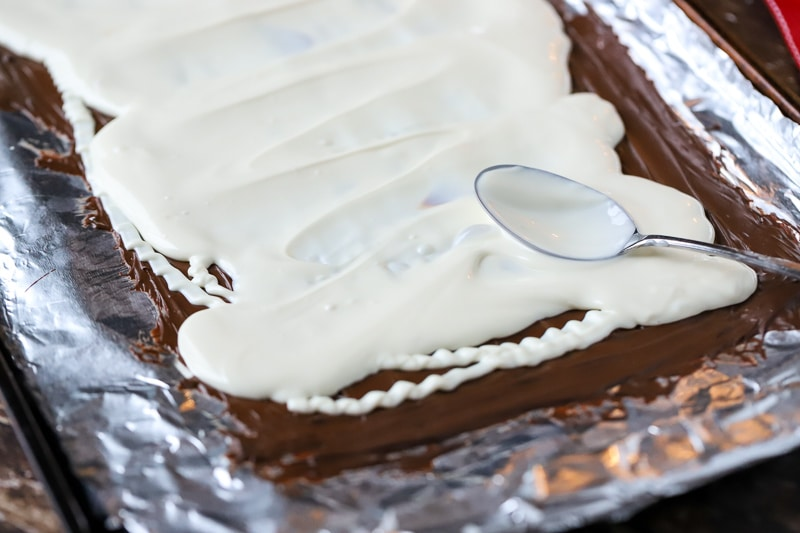 white chocolate being spread in a pan