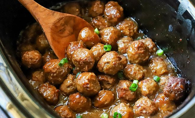 Slow cooker teriyaki meatballs topped with green onions