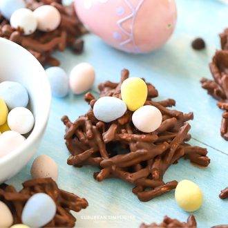 Bird nest cookies with candy next to it.