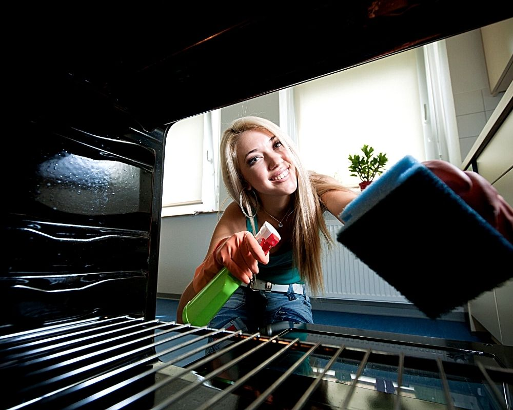 woman cleaning her oven