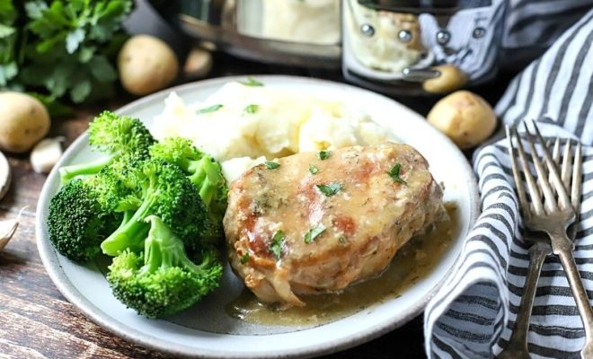 Ranch pork chop on a plate with broccoli