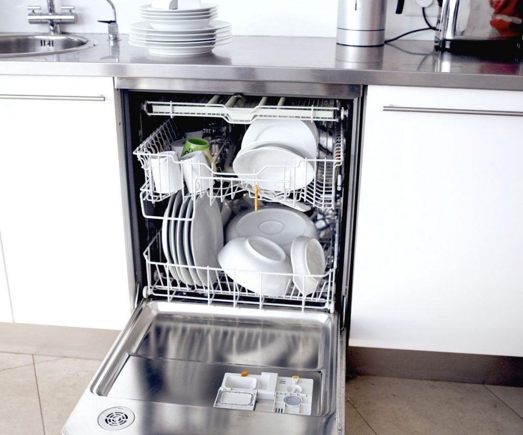 An open dishwasher with clean dishes