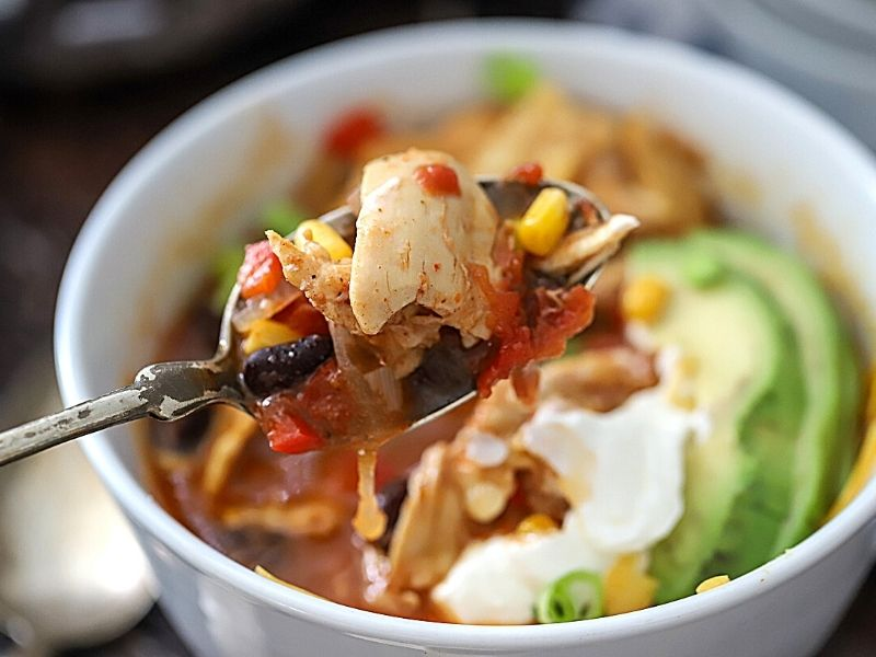 chicken enchilada soup on a spoon