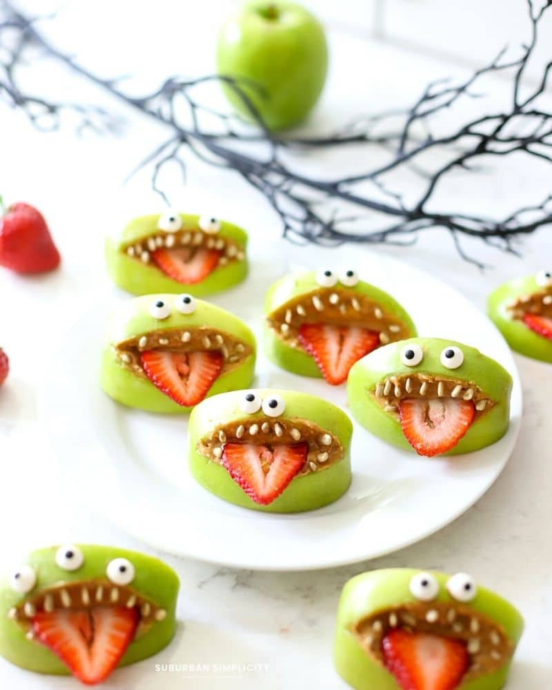 Monster apple mouths on a white plate