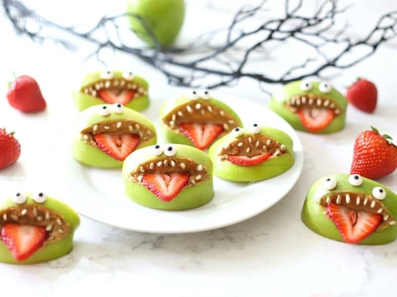 Apple mouths with teeth on a plate