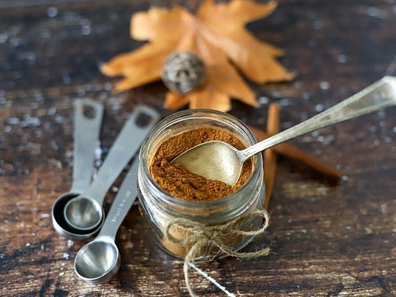 pumpkin spice mix in a jar with a spoon